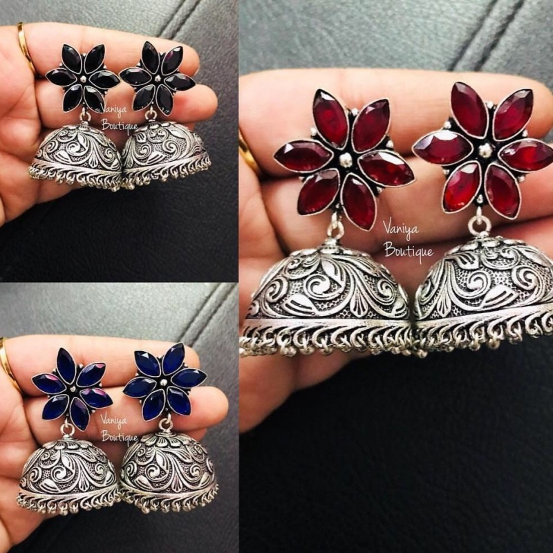 Pair of silvercolored flower earrings with assorted gemstones