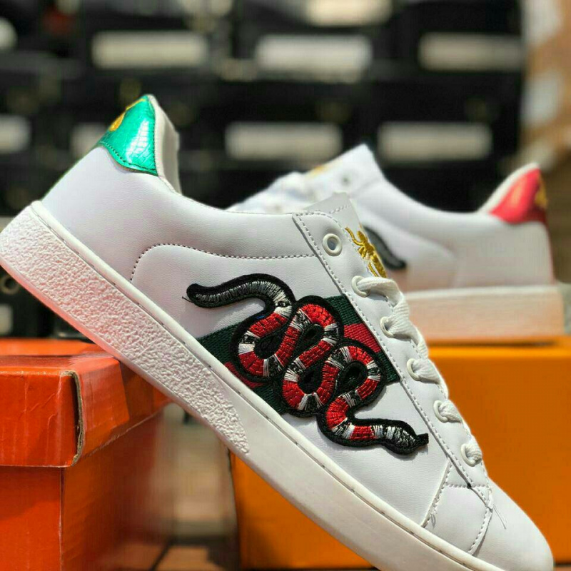 93905c9cdf3 Unpaired white and red Gucci x bee x snake low-top sneaker from Club ...